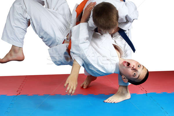 Sportsman with a blue belt doing judo throw Stock photo © Andreyfire