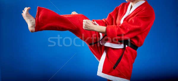 Girl beats a kick leg forward Stock photo © Andreyfire