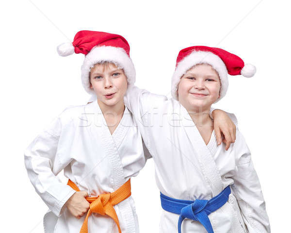 Cheerful friends hugging in a kimono and wearing Santa hat Stock photo © Andreyfire