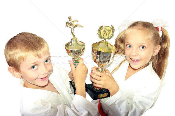 Boy and girl in a kimono with a championship winning in the hands of Stock photo © Andreyfire
