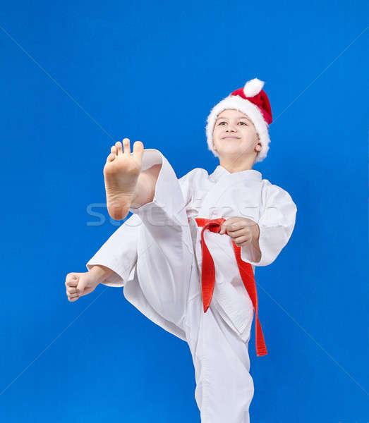 Fiú sapka mikulás rúgás láb egészség Stock fotó © Andreyfire