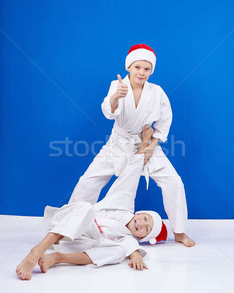 Two athletes trains judo throws Stock photo © Andreyfire