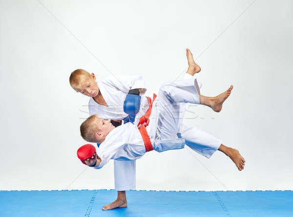 Children are training throws on a blue mats Stock photo © Andreyfire