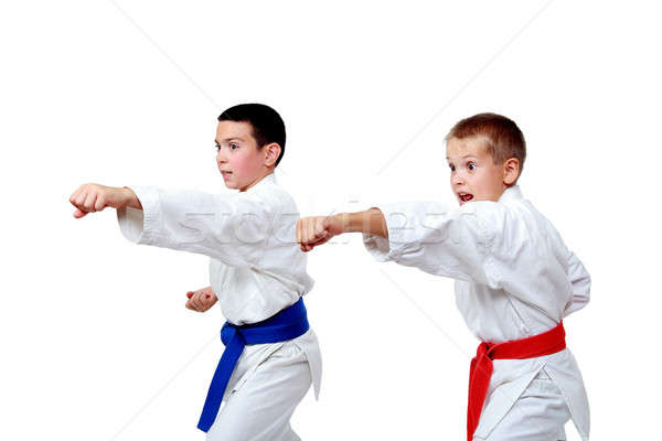 Punch hand athletes on a white background isolated Stock photo © Andreyfire