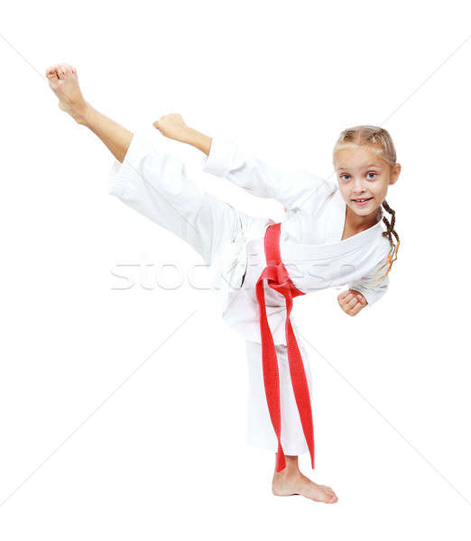 Girl athlete in a kimono performs a kick circular insulated Stock photo © Andreyfire