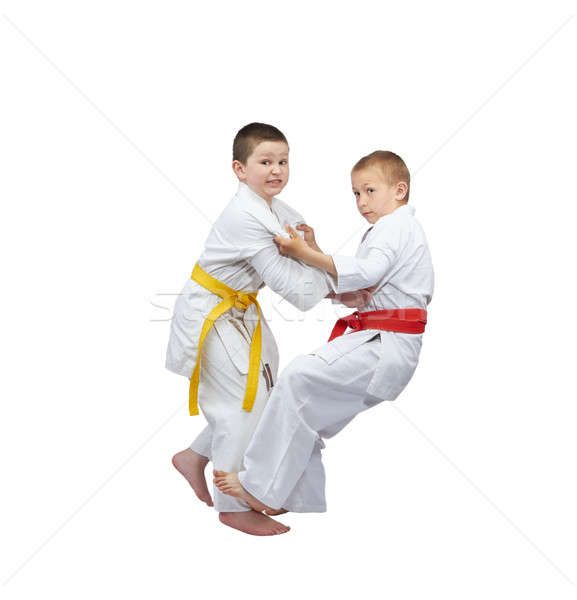 With red and yellow belts athletes are training capture for cast Stock photo © Andreyfire