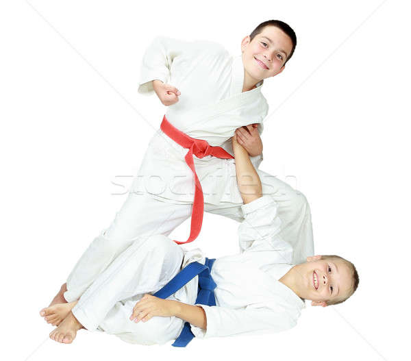A boy throws a baby boy on white background isolated Stock photo © Andreyfire