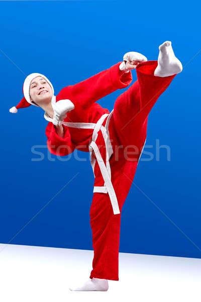 Sportswoman dressed as Santa Claus hits a kick leg Stock photo © Andreyfire