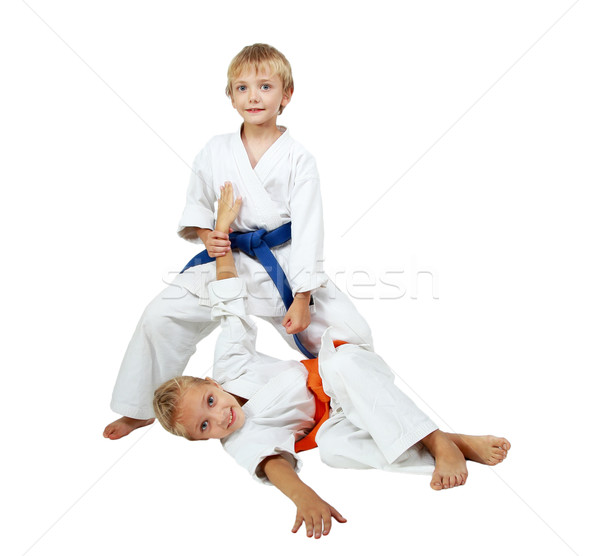 Boy in a kimono after throwing beat a girl in a kimono Stock photo © Andreyfire