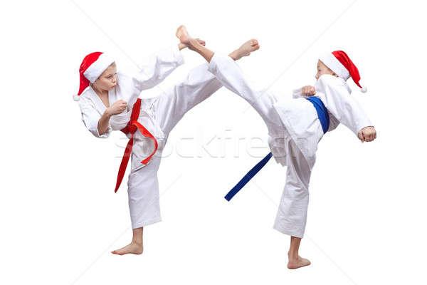 Ativo atletas boné papai noel bater crianças Foto stock © Andreyfire