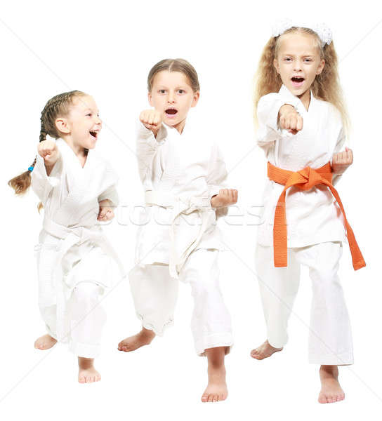 Athletes dressed in white kimono beat hand Stock photo © Andreyfire