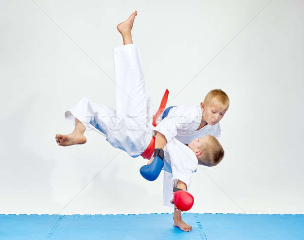 On a blue mats athletes train judo throws Stock photo © Andreyfire