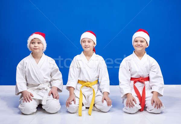 Trois athlètes séance posent karaté fille Photo stock © Andreyfire