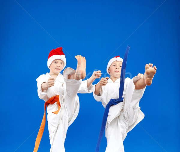 Ninos azul vencer patear pierna ninos Foto stock © Andreyfire