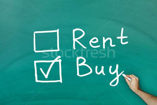 Acheter pas louer vert tableau noir maison Photo stock © AndreyPopov