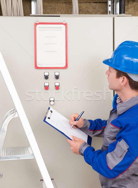 Stockfoto: Portret · bouwvakker · jonge · schrijven · kantoor