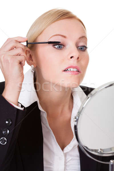 Attractive businesswoman applying mascara Stock photo © AndreyPopov