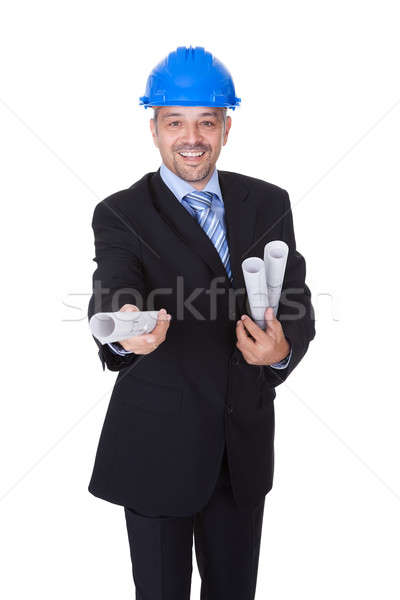 Happy Male Architect Offering Blueprint Stock photo © AndreyPopov