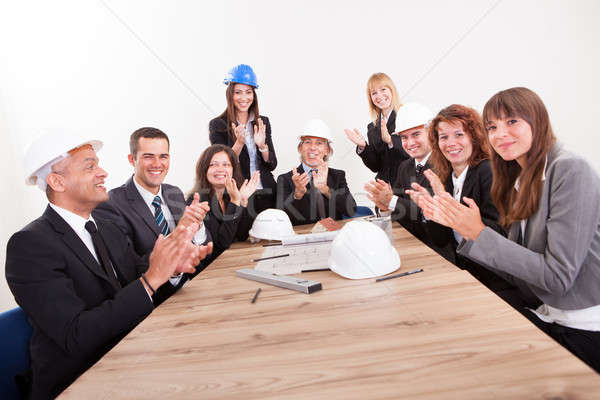 Engineers Sitting At Table And Applauding Stock photo © AndreyPopov