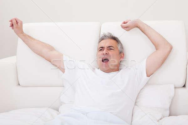 成熟した男 ストレッチング 腕 肖像 腕 ストックフォト © AndreyPopov