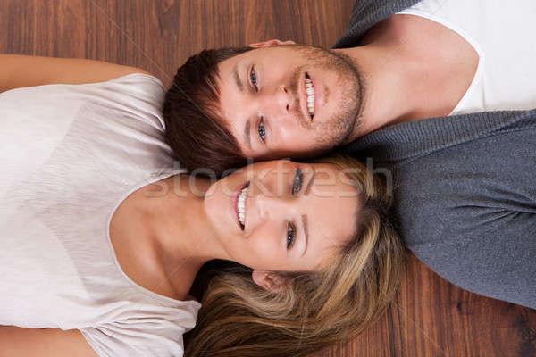 Lie alongside opposite heads Stock photo © AndreyPopov