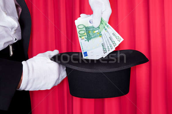 Magicien main 100 euros note Photo stock © AndreyPopov