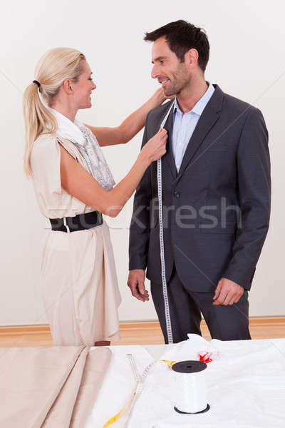 Seamstress measuring a man for a suit Stock photo © AndreyPopov
