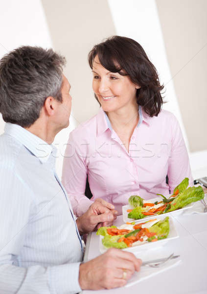 Mature couple having lunch at home Stock photo © AndreyPopov