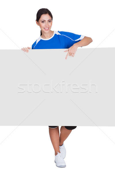 Sporty Woman Holding Blank Placard Stock photo © AndreyPopov