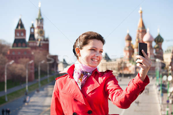 Young woman capturing self portrait Stock photo © AndreyPopov