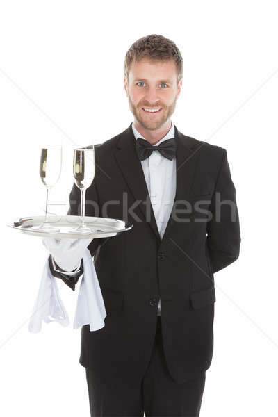 Confident Waiter Carrying Champagne Flutes On Tray Stock photo © AndreyPopov