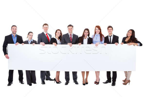 Large group of businesspeople presenting banner Stock photo © AndreyPopov