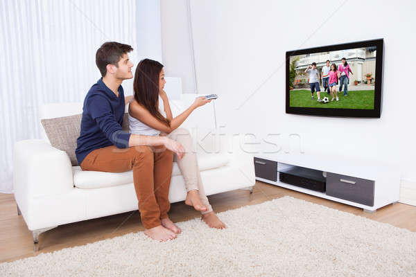 Couple Watching TV In Living Room Stock photo © AndreyPopov