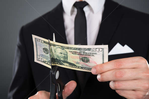 Businessman Cutting Dollar Bill With Scissors Stock photo © AndreyPopov