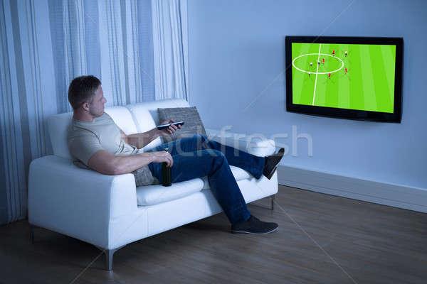 Férfi néz futball játék televízió otthon Stock fotó © AndreyPopov