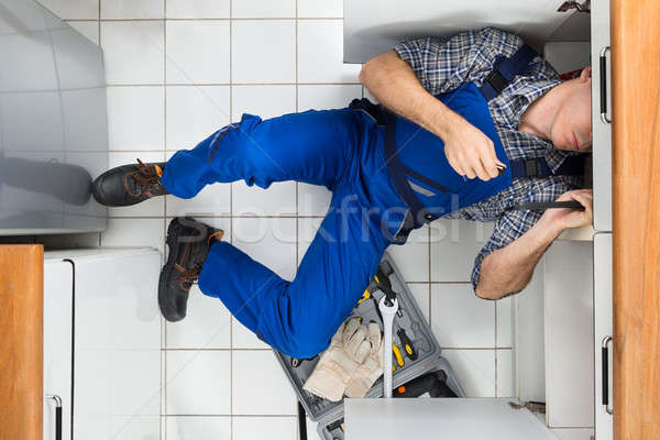 Plumber Repairing Sink Stock photo © AndreyPopov