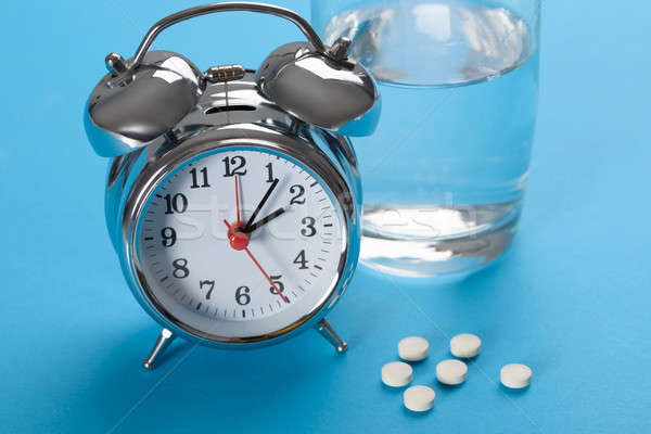 Pills With Glass Of Water And Alarm Clock Stock photo © AndreyPopov
