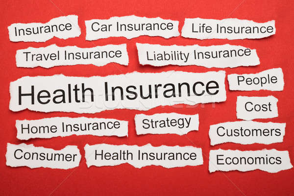 Health Insurance Text On Piece Of Torn Paper Stock photo © AndreyPopov