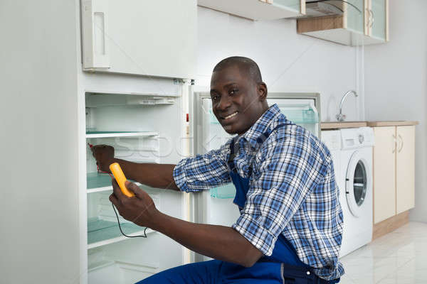 Technician Repairing Refrigerator Appliance Stock photo © AndreyPopov