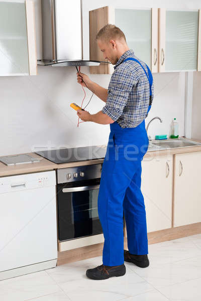 Worker Testing Kitchen Hood With Multimeter Stock photo © AndreyPopov