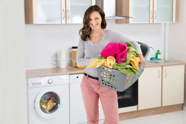 Femme panier à linge heureux cuisine chambre Photo stock © AndreyPopov