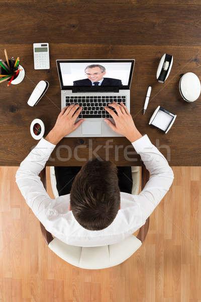 Businessman Videochatting With Senior Colleague Stock photo © AndreyPopov
