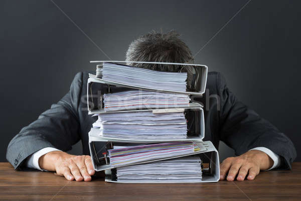 Frustrated Businessman With Lot Of Files On Desk Stock photo © AndreyPopov