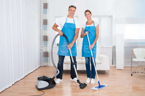 Two Janitors With Vacuum Cleaner And Mop Stock photo © AndreyPopov