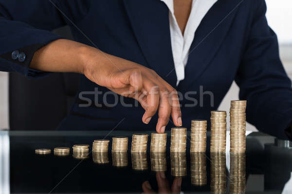 Person's Finger Walking On Pile Of Coins Stock photo © AndreyPopov