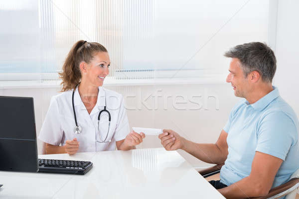 Doctor Giving Medical Prescription To Man Stock photo © AndreyPopov