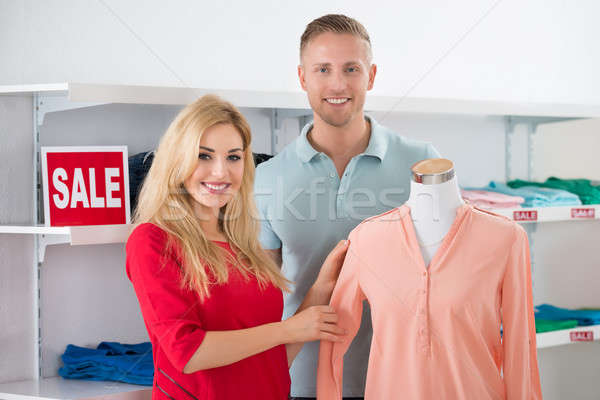 Couple Standing By Mannequin Displaying Top Stock photo © AndreyPopov