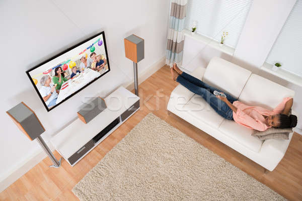 Woman Changing Television Channel Stock photo © AndreyPopov