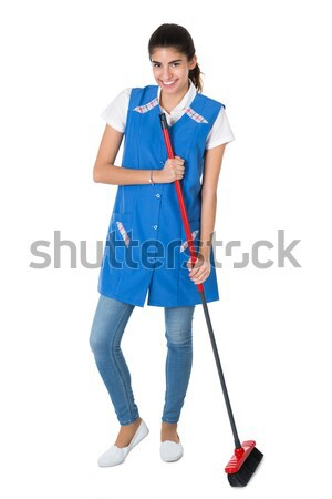 Happy Female Janitor Mopping On White Background Stock photo © AndreyPopov
