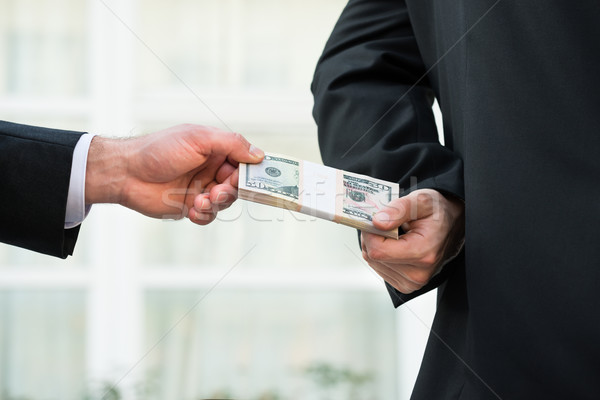 Businessman Taking Bribe From Partner Stock photo © AndreyPopov